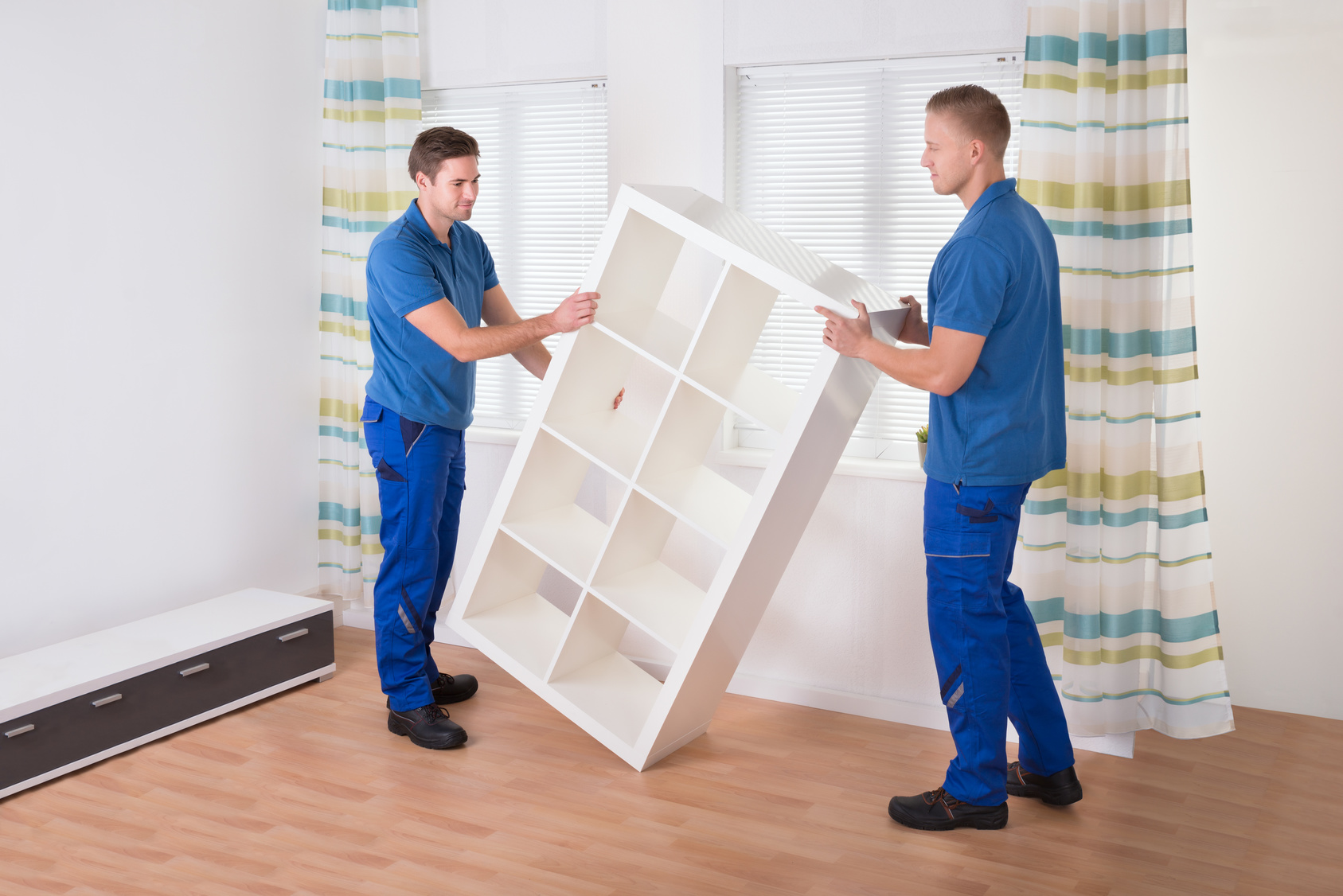 Movers Carrying Shelf At Home